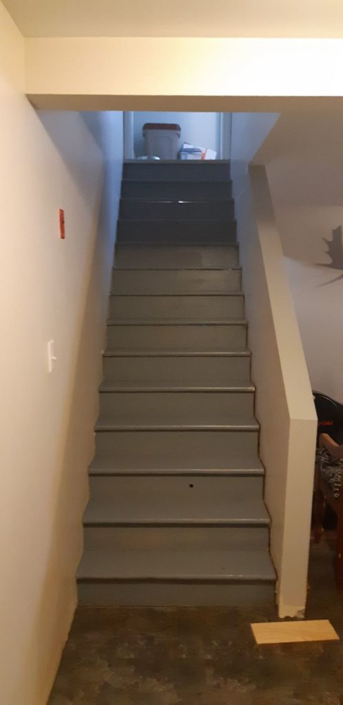 steep stairs without railing found at an inspection