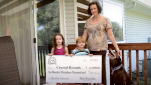 family holding cheque